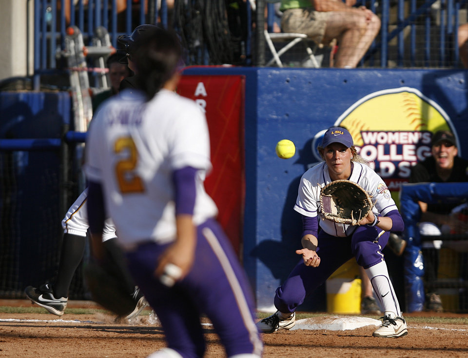LSU's Juliana Santos (2) throws a ball to Dylan Supak (11) during a Women's College World Series game between Arizona State and LSU at ASA Hall of Fame Stadium in Oklahoma City, Saturday, June 2, 2012. Photo by Garett Fisbeck, The Oklahoman