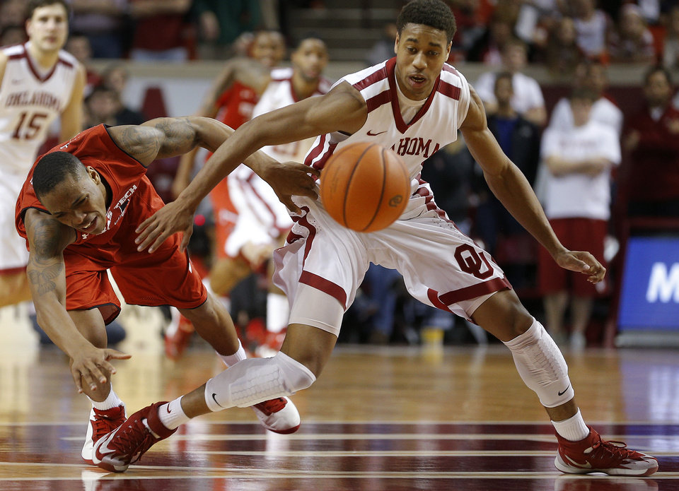 Photo - Oklahoma's Isaiah Cousins (11) steals the ball from Texas Tech's Robert Turner (14) during an NCAA college basketball game between the University of Oklahoma and Texas Tech University at the Lloyd Noble Center in Norman, Okla., Wednesday, Feb. 12, 2014. Oklahoma lost 68-60. Photo by Bryan Terry, The Oklahoman