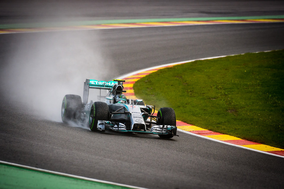 Photo - Mercedes driver Nico Rosberg of Germany steers his car during the qualifying session ahead of Sunday's Belgian Formula One Grand Prix in Spa-Francorchamps, Belgium, Saturday, Aug. 23, 2014. Mercedes driver Nico Rosberg of Germany starts on pole position, Mercedes driver Lewis Hamilton of Britain placed second and Red Bull driver Sebastian Vettel of Germany third. (AP Photo/Geert Vanden Wijngaert)