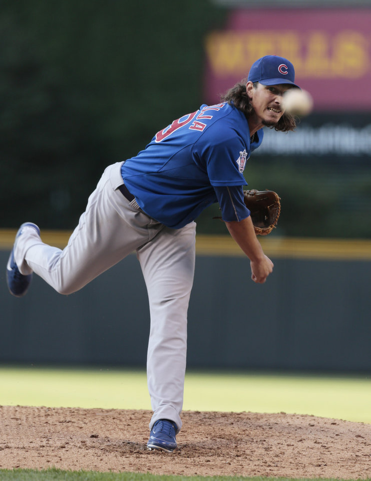 CORRECTS TO JULY 19 NOT 17 - Chicago Cubs starting pitcher Jeff Samardzija delivers against the Colorado Rockies in the first inning of a baseball game in Denver, Friday, July 19, 2013. (AP Photo/Joe Mahoney)