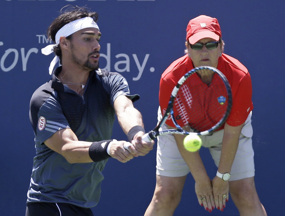 Photo - Fabio Fognini, from Italy, hits a backhand against Miloa Raonic, from Canada, during a match at the Western & Southern Open tennis tournament, Friday, Aug. 15, 2014, in Mason, Ohio. (AP Photo/Al Behrman)