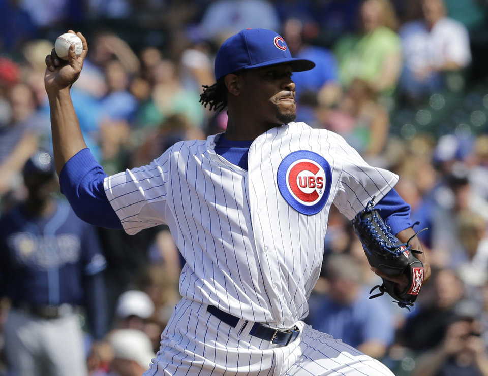 Photo - Chicago Cubs starter Edwin Jackson throws against the Tampa Bay Rays during the first inning of an interleague baseball game in Chicago, Saturday, Aug. 9, 2014. (AP Photo/Nam Y. Huh)