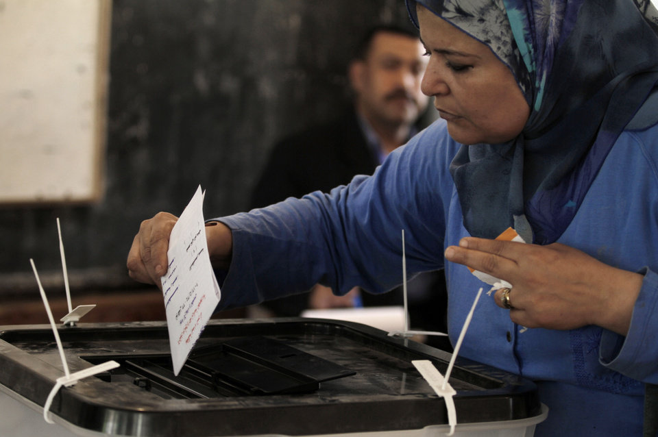 Photo -   An Egyptian woman casts her vote during the first day of the presidential election in a polling center in Alexandria, Egypt, Wednesday, May 23, 2012. Egyptians went to the polls on Wednesday morning to elect a new president after the fall of ex-President Hosni Mubarak last year. (AP Photo/Khalil Hamra)
