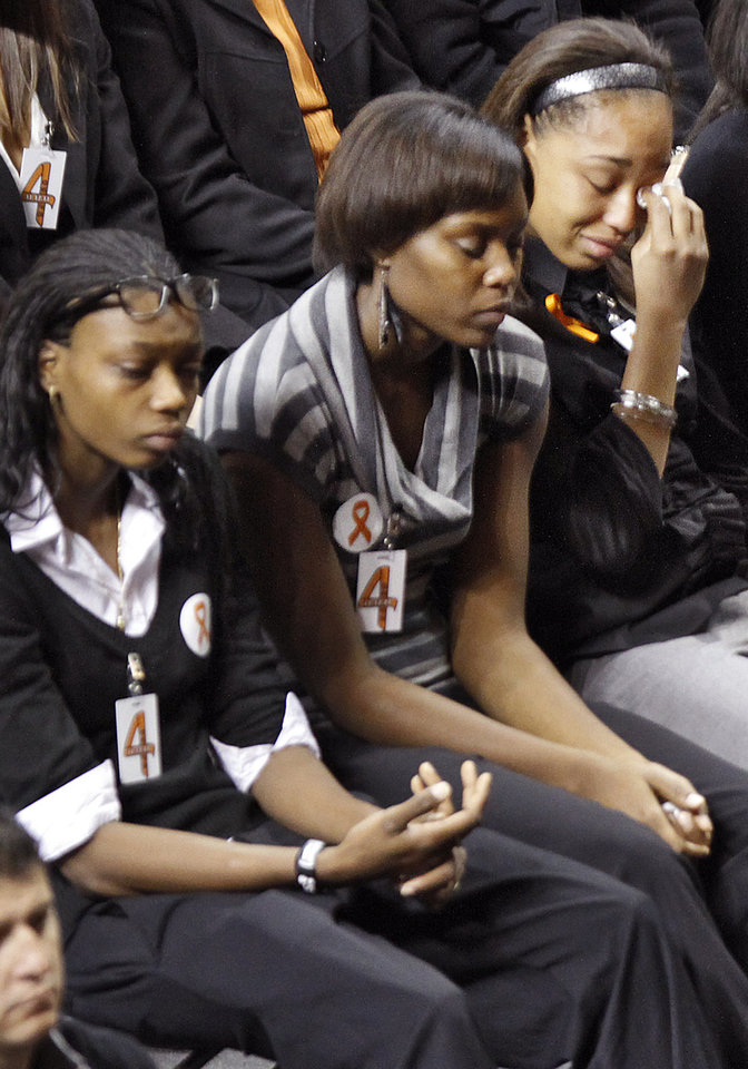 Photo - Members of the Oklahoma State women's basketball team attend the memorial service for Oklahoma State head basketball coach Kurt Budke and assistant coach Miranda Serna at Gallagher-Iba Arena on Monday, Nov. 21, 2011 in Stillwater, Okla. The two were killed in a plane crash along with former state senator Olin Branstetter and his wife Paula while on a recruiting trip in central Arkansas last Thursday. Photo by Chris Landsberger, The Oklahoman
