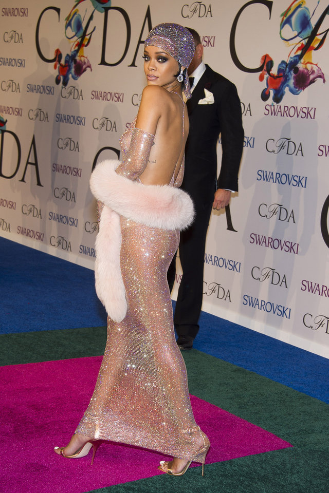 Photo - Rihanna attends the CFDA Fashion Awards on Monday, June 2, 2014 in New York. (Photo by Charles Sykes/Invision/AP)