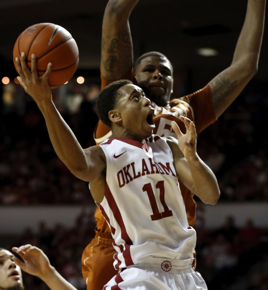 Photo - Oklahoma Sooner Isaiah Cousins (11) shoots guarded by Texas Longhorn's Cameron Ridley (55) in the second half as the University of Oklahoma Sooners (OU) men defeat the Texas Longhorns (TU) 77-65 in NCAA, college basketball at The Lloyd Noble Center on Saturday, March 1, 2014  in Norman, Okla. Photo by Steve Sisney, The Oklahoman