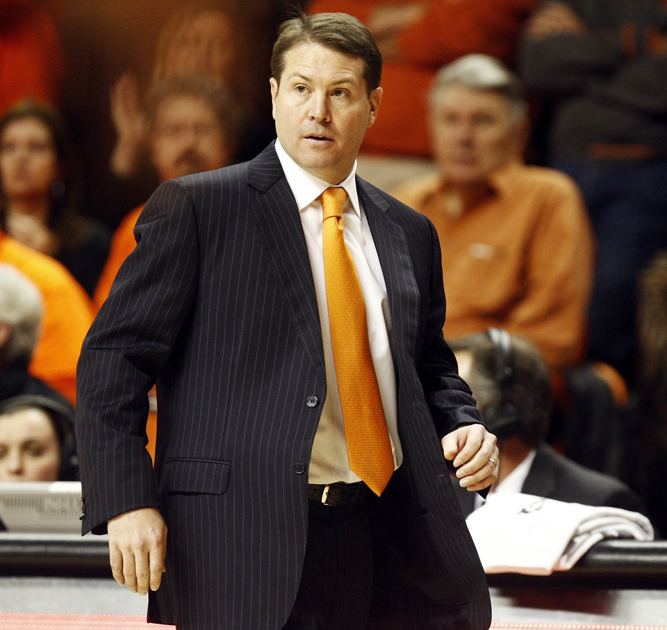 Photo - OSU head coach Travis Ford during a men's college basketball game between Oklahoma State University (OSU) and Gonzaga at Gallagher-Iba Arena in Stillwater, Okla., Monday, Dec. 31, 2012. Gonzaga won, 69-68. Photo by Nate Billings, The Oklahoman
