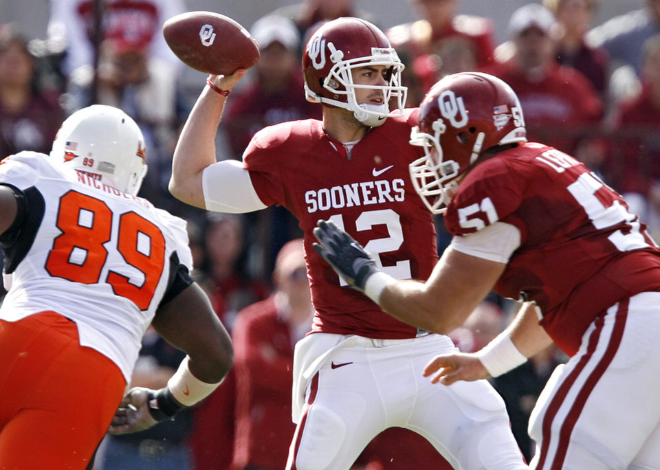 Photo - Oklahoma's Landry Jones (12) looks to throw the ball during the first half of the Bedlam college football game between the University of Oklahoma Sooners (OU) and the Oklahoma State University Cowboys (OSU) at the Gaylord Family-Oklahoma Memorial Stadium on Saturday, Nov. 28, 2009, in Norman, Okla.Photo by Chris Landsberger, The Oklahoman