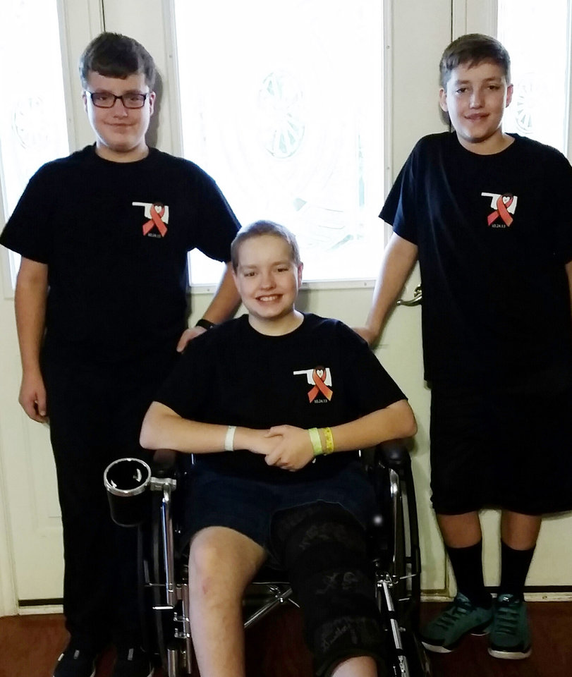 Photo - Alleyn Campbell, center, poses for a photo with his brothers, Brandon (left) and Collen (right). Alleyn is recovering from injuries caused by the crash at Oklahoma State UniversityÕs homecoming parade. [Photo submitted]