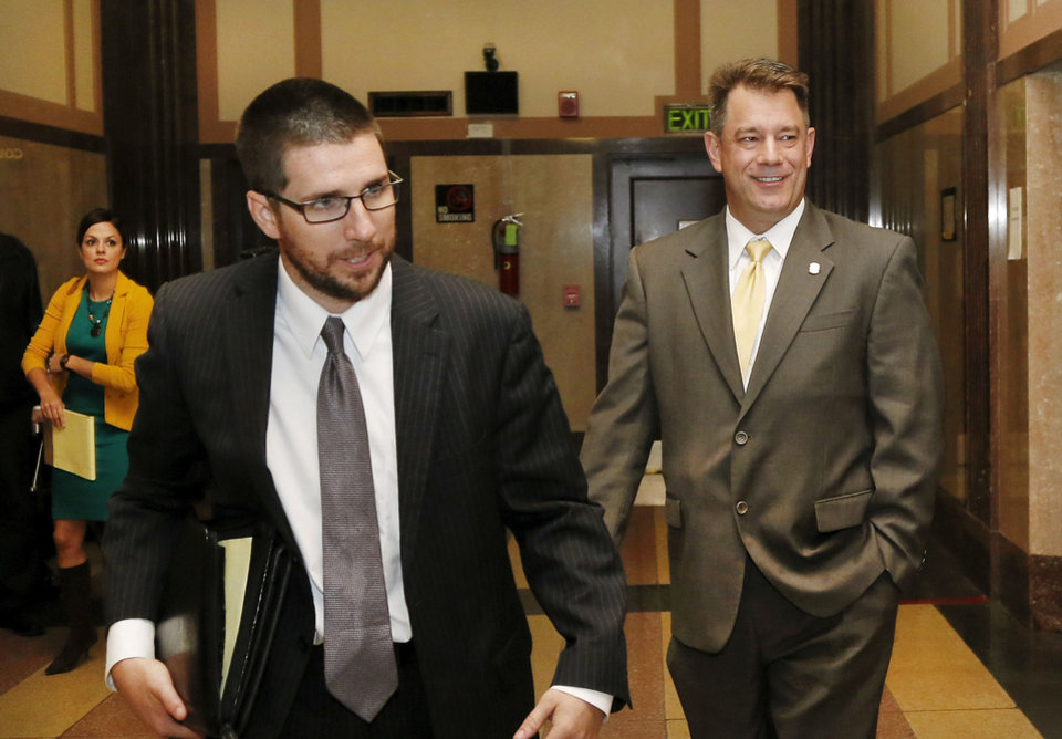 Photo - State Rep. Mike Christian, right, follows his attorney out of the courtroom after testifying Wednesday.   Jim Beckel - THE OKLAHOMAN