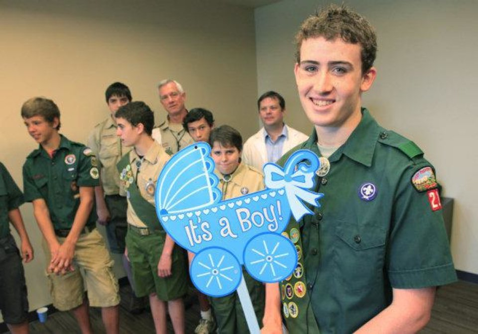 Photo - Boy Scout Nate Yokell holds a sign at the new Integris Health Edmond. If the first baby born at the hosptial is a boy, the Boy Scouts will get a monetary prize. If it's a girl, the donation will go to the Girl Scouts. PHOTO BY DAVID MCDANIEL, THE OKLAHOMAN   David McDaniel