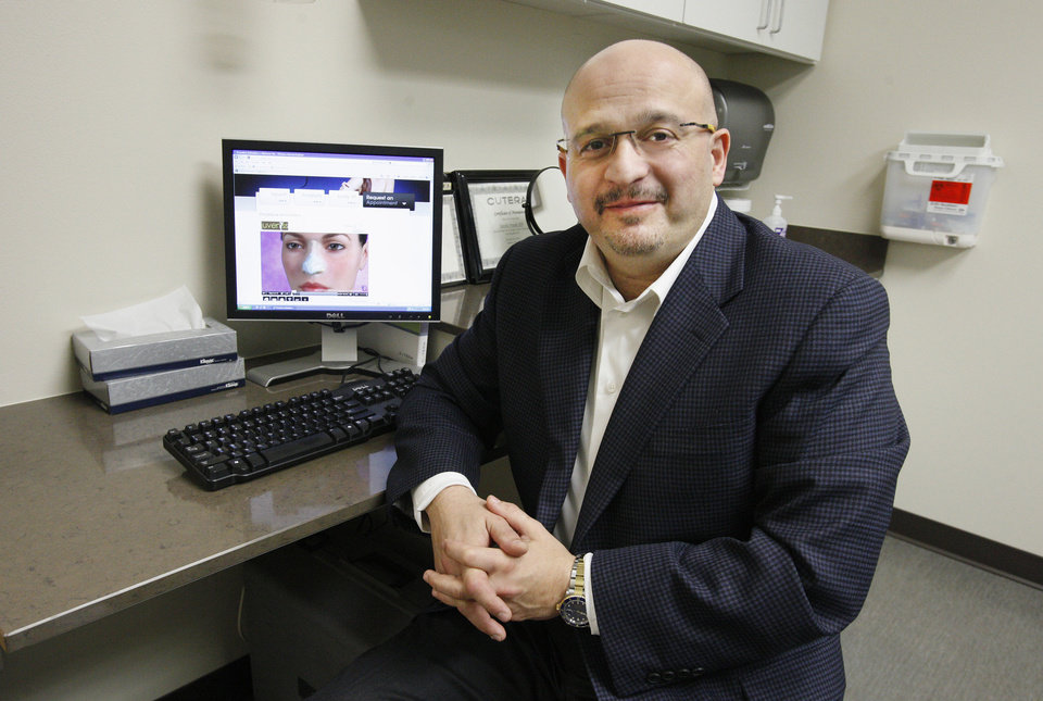 Dr. Kamal Sawan, chief of plastic surgery at OU Physicians, performs rhinoplasty, or nose jobs, using an open technique. Sawan says this technique allows him a better visual on the patient�s nose structure.  PHOTO BY PAUL B. SOUTHERLAND, THE OKLAHOMAN