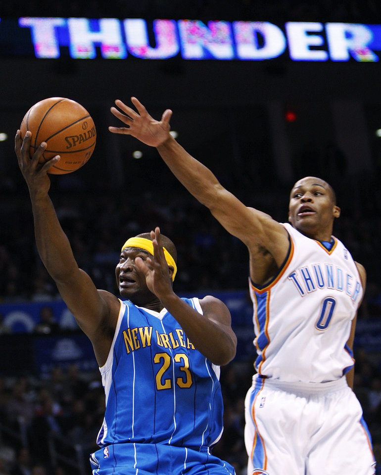 Photo - New Orleans Hornets guard Devin Brown, left, goes up for a shot in front of Oklahoma City Thunder guard Russell Westbrook, right, in the first quarter of an NBA basketball game in Oklahoma City, Friday, Nov. 21, 2008. (AP Photo/Sue Ogrocki) ORG XMIT: OKSO102