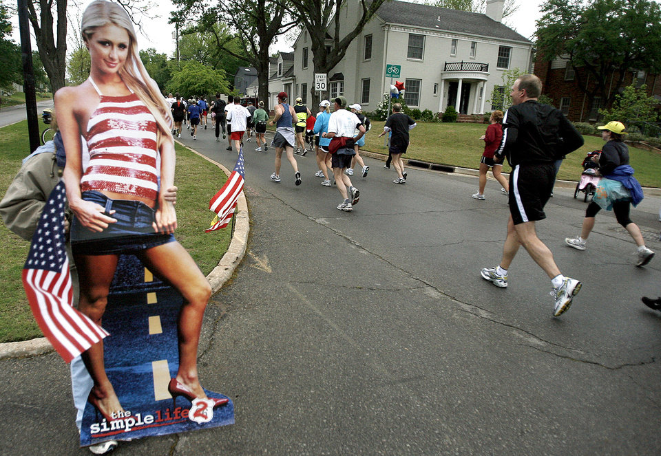 A spectator holds a Paris Hilton cutout to encourage runners up Shartel Ave. during the  8th annual Oklahoma City Memorial Marathon on Sunday, April 27, 2008, in Oklahoma City, Okla. Jett brought the John Wayne cutout to entertain runners.