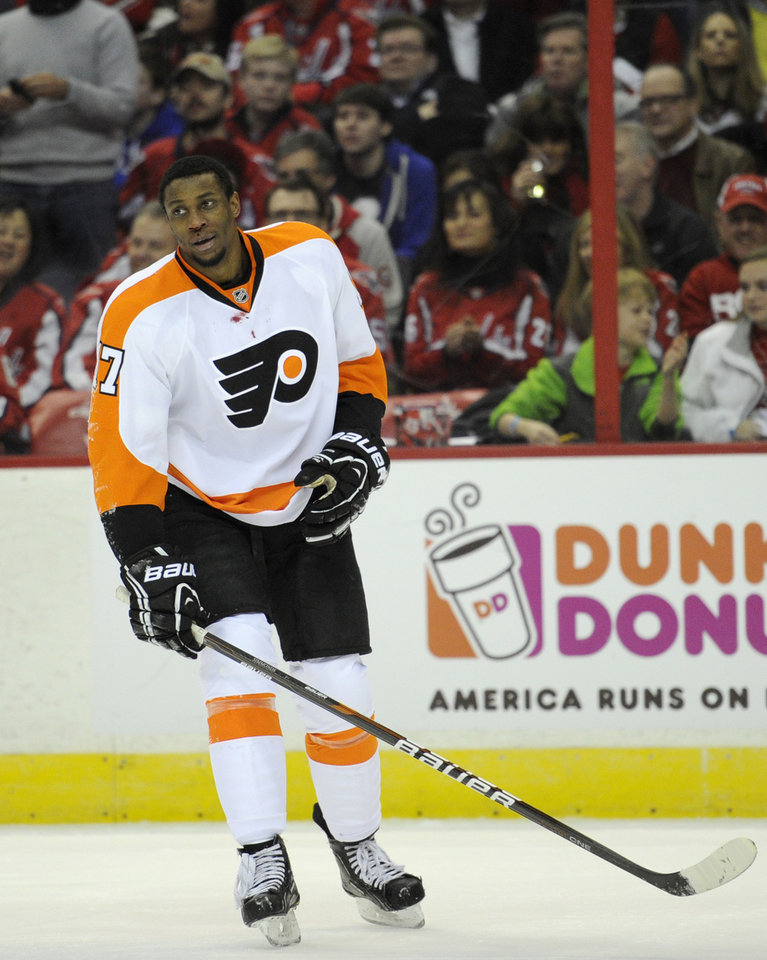 Philadelphia Flyers right wing Wayne Simmonds (17) leaves the ice after being injured against the Washington Capitals during the first period of an NHL hockey game on Friday, Feb. 1, 2013, in Washington. The Capitals won 3-2. (AP Photo/Nick Wass)