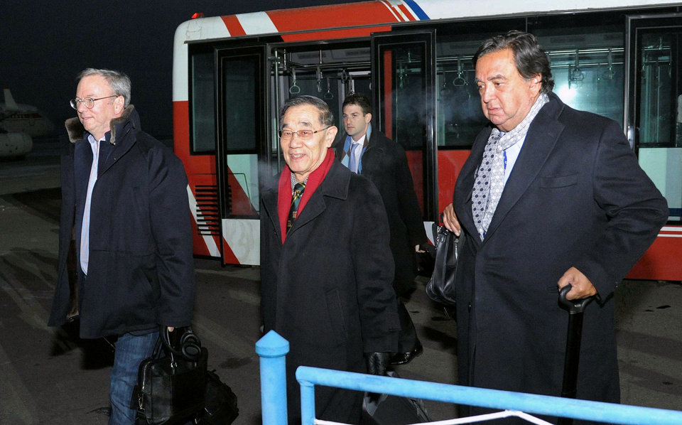 Photo - Eric Schmidt, executive chairman of Google, left, and former New Mexico Gov. Bill Richardson, right, arrive at an airport in Pyongyang, North Korea, Monday, Jan. 7, 2013.  The Google chairman wants a first-hand look at North Korea's economy and social media in his private visit Monday to the communist nation, his delegation said, despite misgivings in Washington over the timing of the trip.  (AP Photo/Kyodo News) JAPAN OUT, MANDATORY CREDIT, NO LICENSING IN CHINA, HONG KONG, JAPAN, SOUTH KOREA AND FRANCE