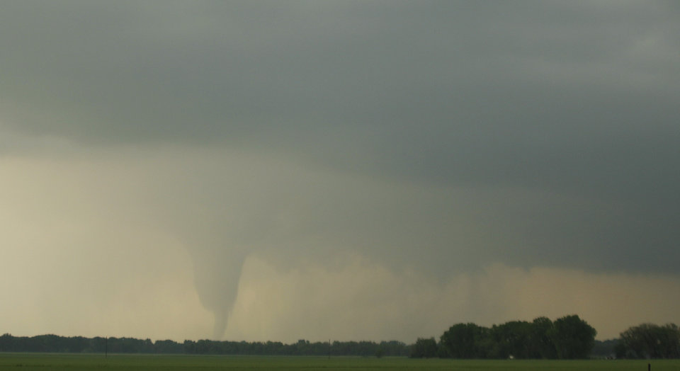 Photo -   A tornado forms and touches down north of Soloman, Kan., Saturday, April 14, 2012. (AP Photo/Orlin Wagner)