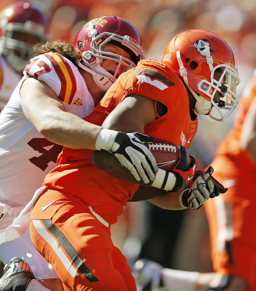 Photo - Iowa State's A.J. Klein (47) tackles Oklahoma State's Joseph Randle (1) on a carry during a college football game between Oklahoma State University (OSU) and Iowa State University (ISU) at Boone Pickens Stadium in Stillwater, Okla., Saturday, Oct. 20, 2012. Photo by Nate Billings, The Oklahoman