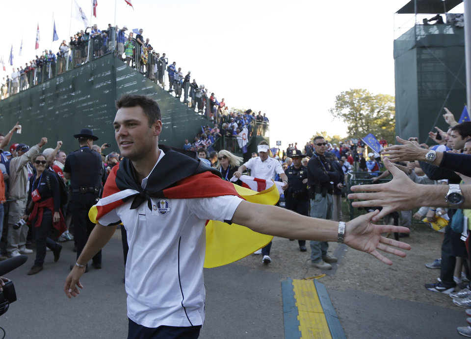 Photo - Europe's Martin Kaymer celebrates after winning the Ryder Cup PGA golf tournament Sunday, Sept. 30, 2012, at the Medinah Country Club in Medinah, Ill. (AP Photo/David J. Phillip)  ORG XMIT: PGA229