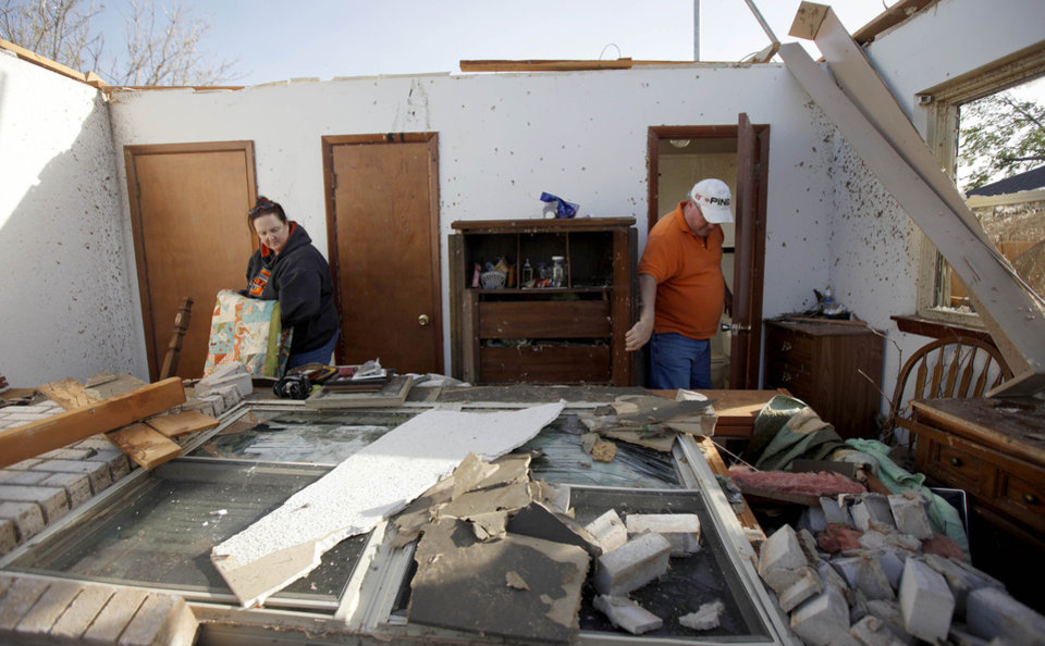 Pam, left, and Terry Nelson sort through items inside the home of Terry's mother after a tornado damaged the home in Woodward, Okla., Sunday, April 15, 2012. Photo by Bryan Terry