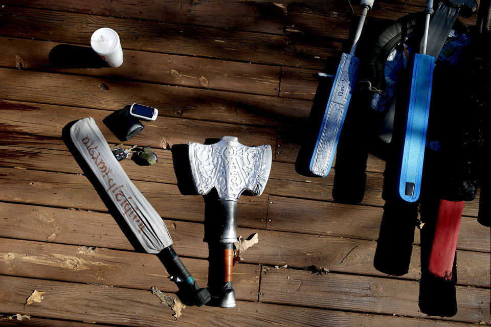 Photo - A display of Dagorhir weapons used during practice at E.C. Hafer Park. Players practice with foam weapons. PHOTO BRYAN TERRY, THE OKLAHOMAN.  BRYN TERRY - THE OKLAHOMAN