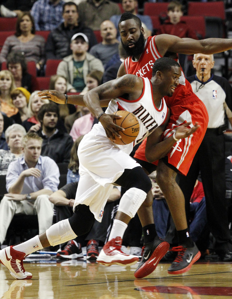 Portland Trail Blazers guard Wesley Matthews, left, drives on Houston Rockets guard James Harden during the first half of their NBA basketball game in Portland, Ore., Friday, Nov. 16, 2012.(AP Photo/Don Ryan)