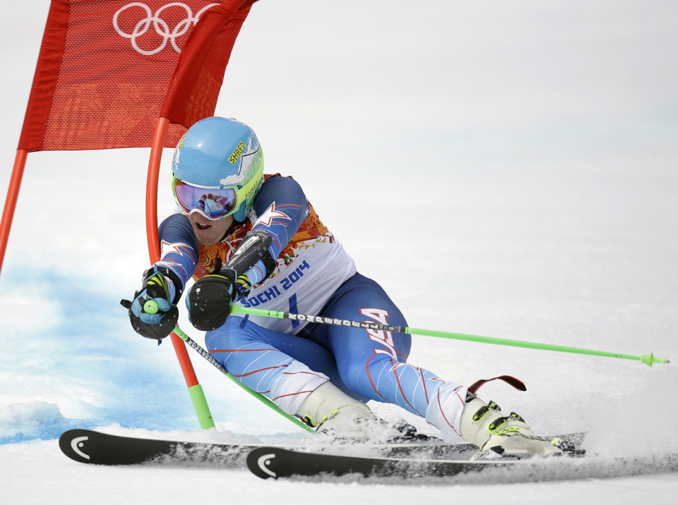 Photo - United States' Ted Ligety passes a gate in the first run of the men's giant slalom at the Sochi 2014 Winter Olympics, Wednesday, Feb. 19, 2014, in Krasnaya Polyana, Russia. (AP Photo/Luca Bruno)