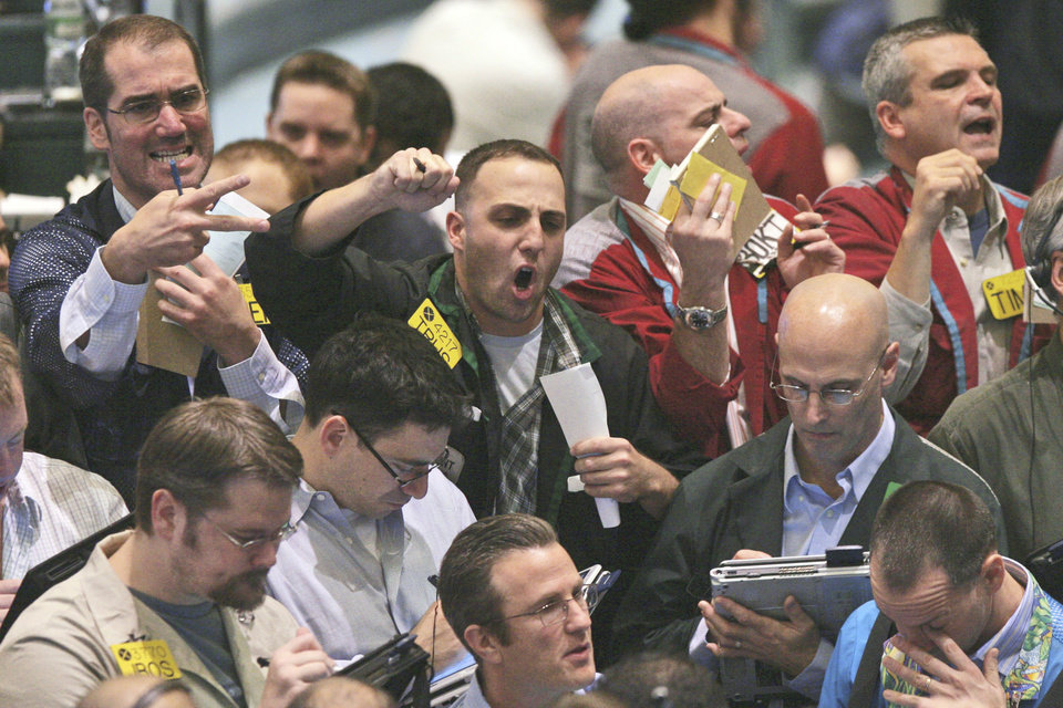 Photo - Traders work the crude oil options pit at the New York Mercantile Exchange on Friday. Ap Photo