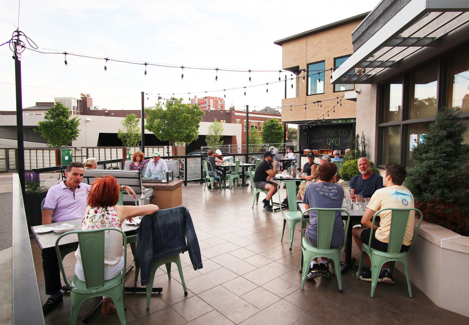 Photo - Stella Modern Italian has started limited service back up, keeping dine in customers on the patio, Friday, May 1, 2020. [Doug Hoke/The Oklahoman]