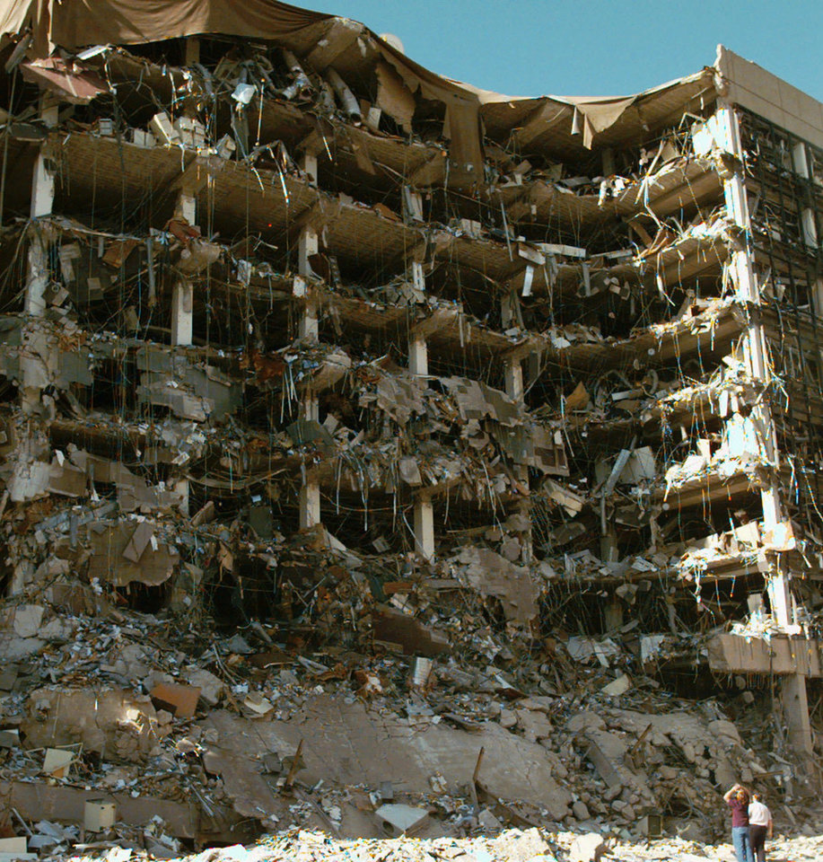 Photo - FILE - This April 19, 1995 file photo shows rescue workers standing in front of the Alfred P. Murrah Federal Building following an explosion in downtown Oklahoma City. Sony Electronics and the Nielsen television research company collaborated on a survey ranking TV's most memorable moments. Other TV events include, the Sept. 11 attacks in 2001, Hurricane Katrina in 2005, the O.J. Simpson murder trial verdict in 1995 and the death of Osama bin Laden in 2011. (AP Photo/David Longstreath, File) ORG XMIT: NYET129