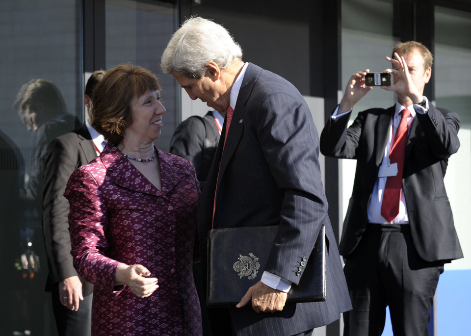 Photo - U.S. Secretary of State John Kerry is greeted by European Union High Representative Catherine Ashton as he arrives for a meeting of EU Ministers of Foreign Affairs at the National Gallery of Art in Vilnius, Lithuania, Saturday, Sept. 7, 2013. Kerry traveled to Europe to court international support for a possible strike on the Syrian regime for its alleged use of chemical weapons while making calls back home to lobby Congress where the action faces an uphill battle. (AP Photo/Susan Walsh, Pool)