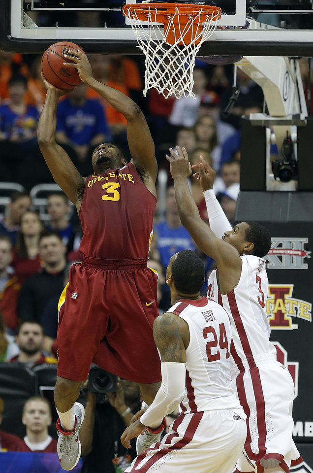 Iowa State's Melvin Ejim (3) shoots as Oklahoma's Romero Osby (24) and Buddy Hield (3) defend during the Phillips 66 Big 12 Men's basketball championship tournament game between the University of Oklahoma and Iowa State at the Sprint Center in Kansas City, Thursday, March 14, 2013. Photo by Sarah Phipps, The Oklahoman