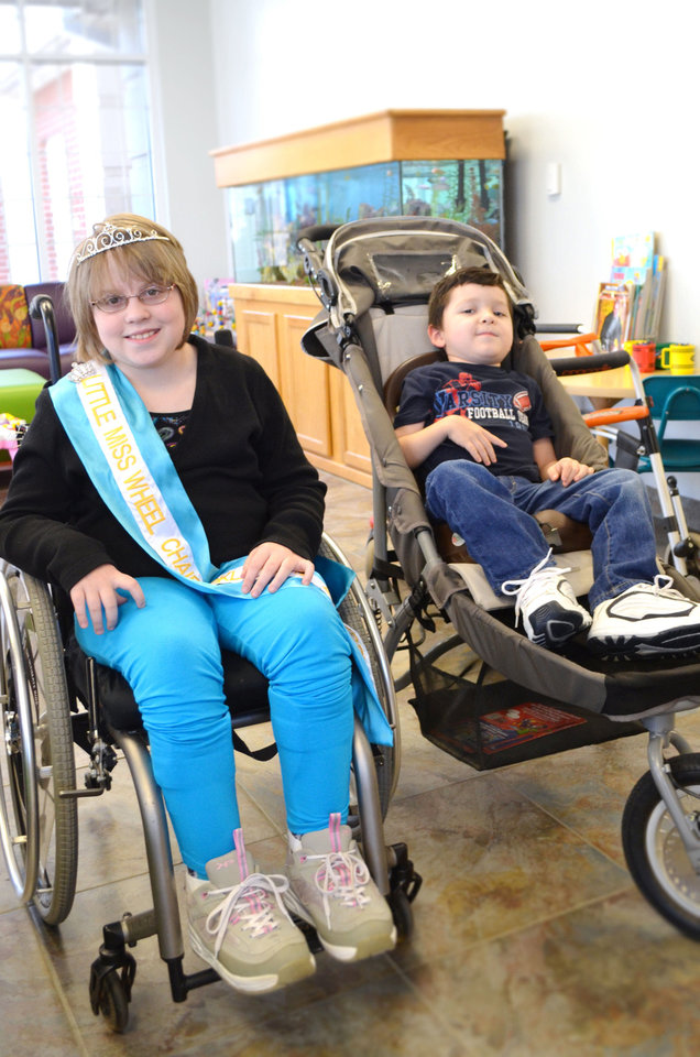 Lauren Smith, Little Miss Wheelchair of Oklahoman, with Beau McKenna, 5, a patient at The Children's Center.  PHOTO BY TRAVIS DOUSSETTE, THE CHILDREN'S CENTER <strong></strong>