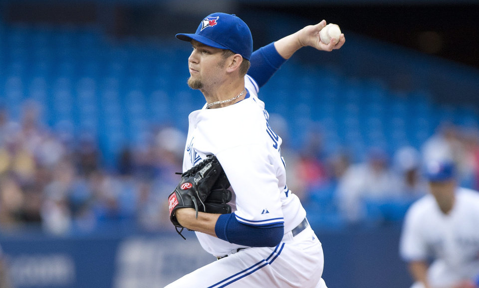 Photo - Toronto Blue Jays starting pitcher Josh Johnson throws during the first inning of a game against the Los Angeles Dodgers in Toronto on Monday July 22, 2013. (AP Photo/The Canadian Press, Frank Gunn)