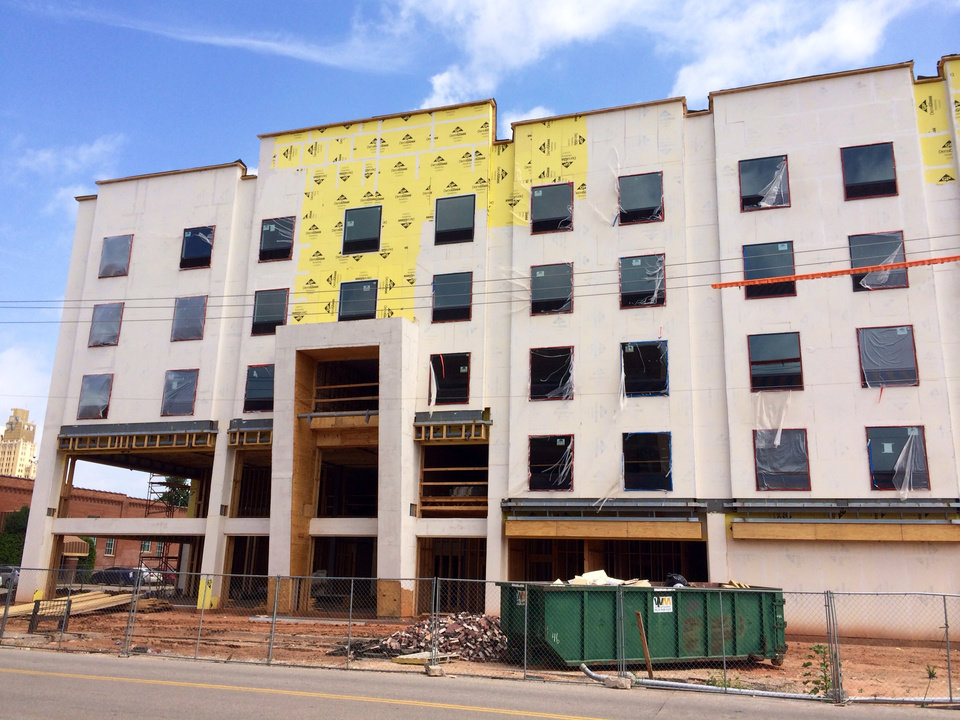 Photo -       A new 124-room Holiday Inn Express is making its home in Bricktown. A brick facade is going up on the building to compliment the district's historic brick warehouses. Taken on Tuesday June 17 2014 at E Main and N Oklahoma Avenue by NewsOK contributor Will Hider.