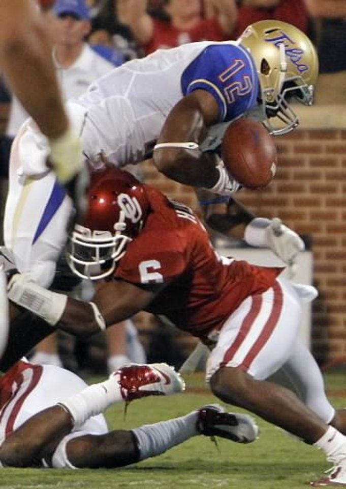 Photo - Oklahoma's Demontre Hurst (6) forces a fumble near the goal line on Tulsa's Jordan James (12) during the college football game between the University of Oklahoma Sooners ( OU) and the Tulsa University Hurricanes (TU) at the Gaylord Family-Memorial Stadium on Saturday, Sept. 3, 2011, in Norman, Okla. Photo by Chris Landsberger, The Oklahoman ORG XMIT: KOD