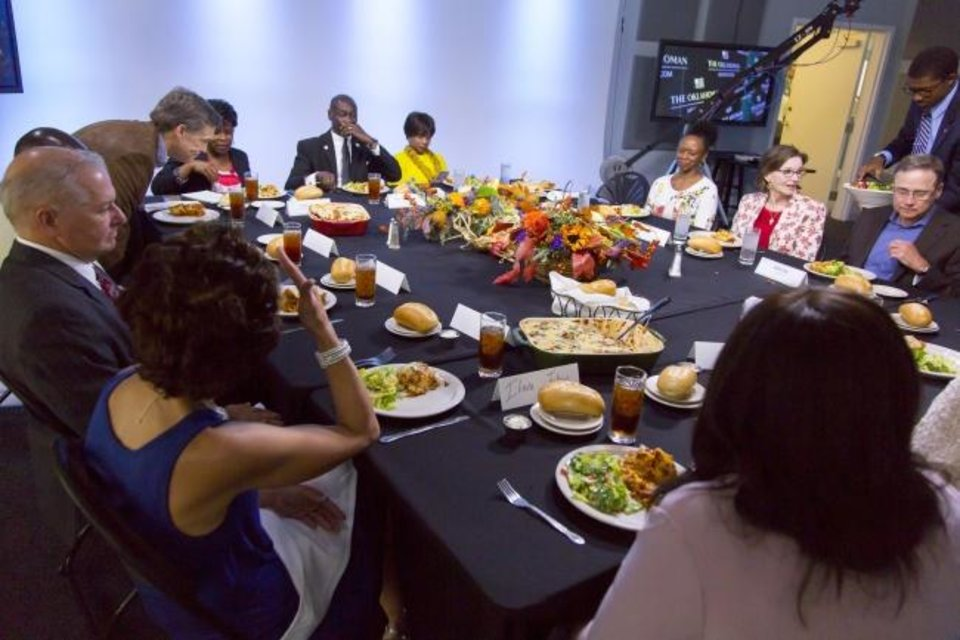Photo -  People from different races and backgrounds eat together during The Oklahoman's Sunday Conversation dinner at the newspaper's office, 100 W Main. The 2016 dinner typifies an event that would be highlighted through the United Voice Oklahoma initiative. [The Oklahoman Archives]