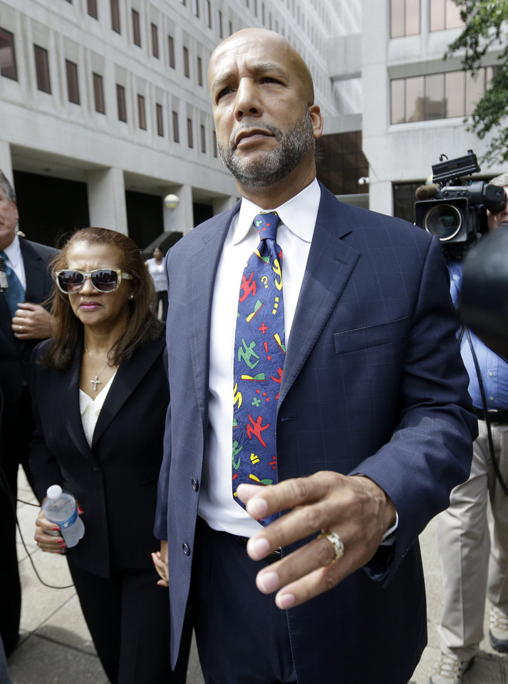 Photo - IDENTIFIES WOMAN AT LEFT - Former New Orleans Mayor Ray Nagin leaves federal court with his wife, Seletha Nagin, left, after being sentenced in New Orleans, Wednesday, July 9, 2014. Nagin was sentenced to 10 years in prison for bribery, money laundering and other corruption that spanned his two terms as mayor, including the chaotic years after Hurricane Katrina hit in 2005. He was convicted Feb. 12 of accepting hundreds of thousands of dollars from businessmen who wanted work from the city or Nagin's support for various projects. The bribes came in the form of money, free vacations and truckloads of free granite for his family business. (AP Photo/Gerald Herbert)