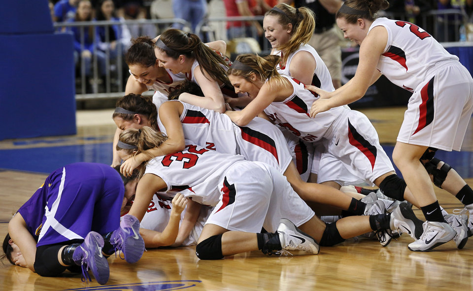 Photo - Anadarko junior Ashley Beatty, far left,  drops to the floor and sobs while a victorious Ft. Gibson team celebrates behind her at the end of the Class 4A State championship game between Ft. Gibson and Anadarko at Jim Norick Arena at State Fair Park  on Saturday, Mar. 15, 2014. Ft. Gibson came from behind much of the second half to win 50-47.  Photo by Jim Beckel, The Oklahoman