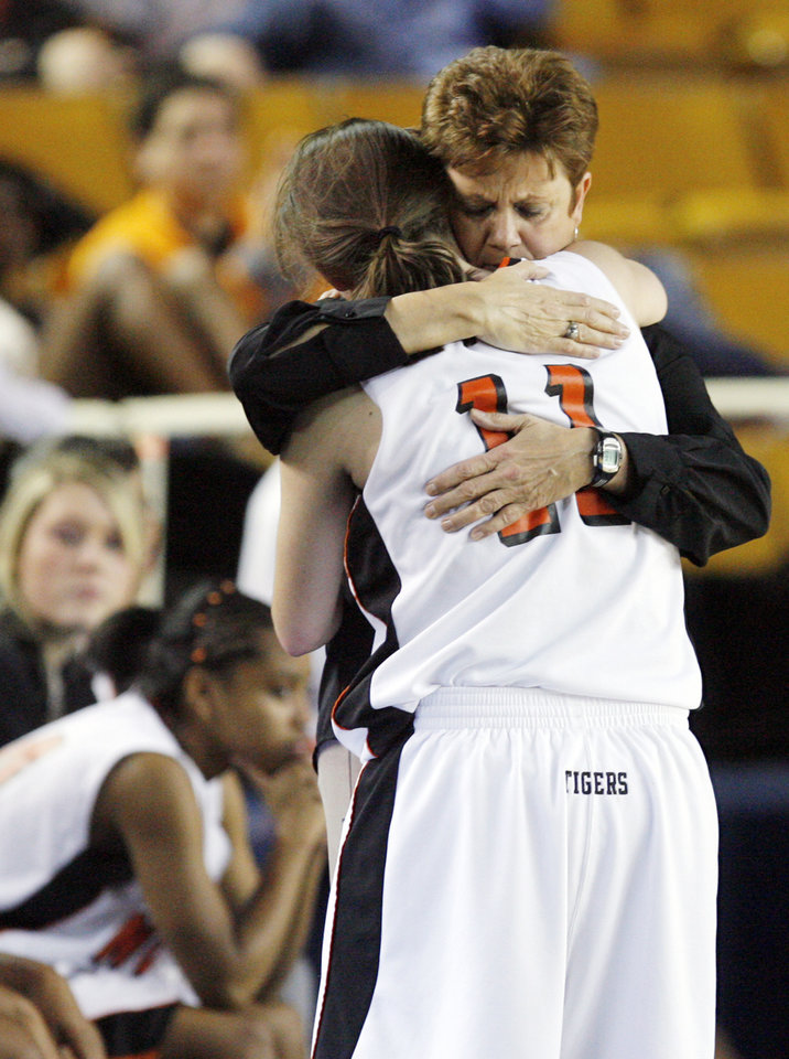 Photo - Norman head coach Matlida Mossman hugs Chelsea Key (11) after Key fouled out of the Class 6A girls high school basketball state tournament final between Midwest City and Norman at the ORU Mabee Center in Tulsa, Okla., Saturday, March 13, 2010. Midwest City won, 46-32. Photo by Nate Billings, The Oklahoman