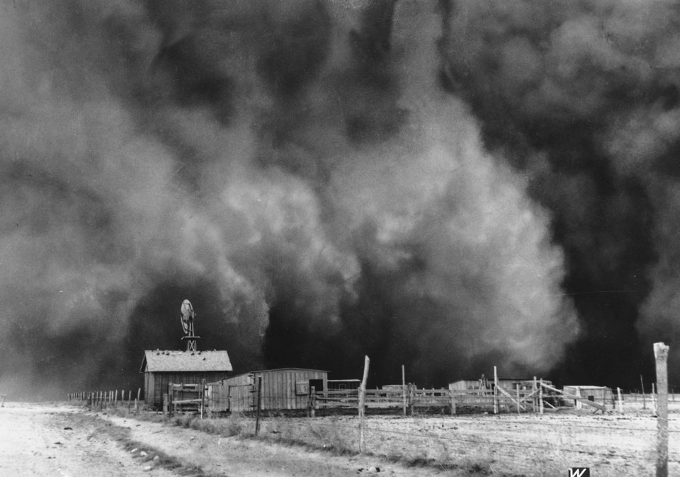 Photo -  The Dust Bowl was harsh on the land and its Oklahoma inhabitants, as shown in this 1935 photo of a giant dust cloud about to engulf a ranch in Boise City. [AP Photo]