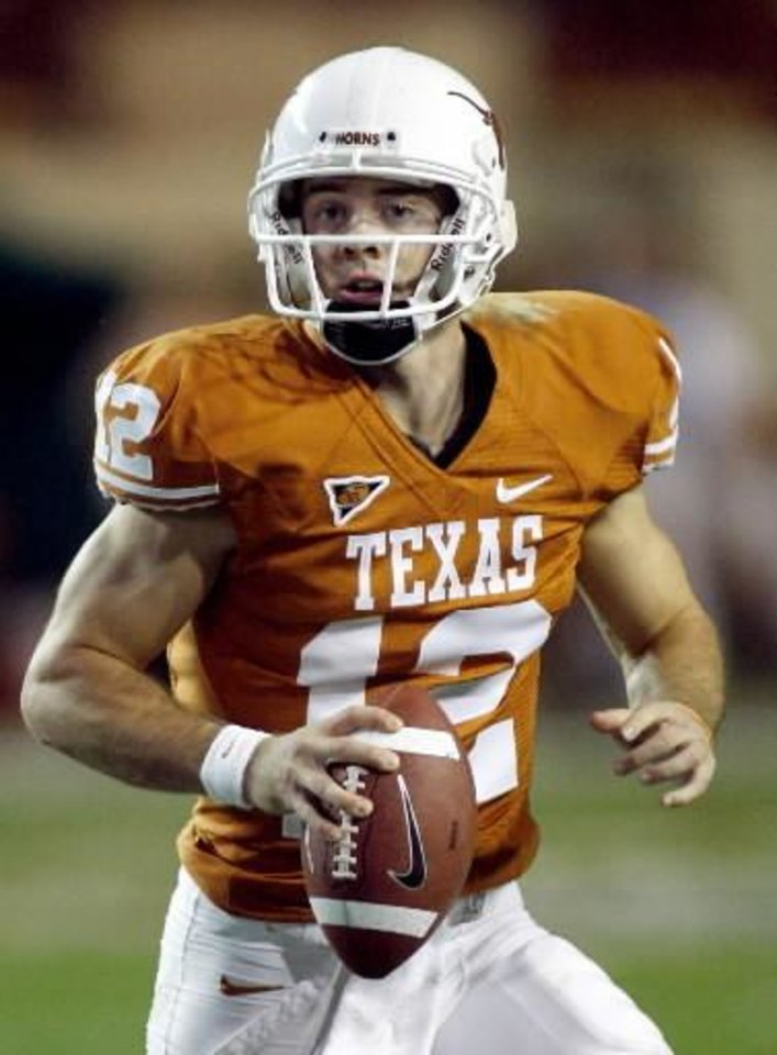 Photo -  In this Nov. 27, 2008 file photo, Texas junior quarterback  Colt  McCoy rolls to his left and looks toward receiver during an NCAA college football game against Texas A&M, in Austin, Texas.  McCoy was selected as The Associated Press' Big 12 offensive player of the year. (AP Photo/Harry Cabluck, File)