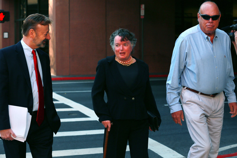Photo - Former San Diego mayor Maureen O'Connor, center, walks to federal court in San Diego Thursday, Feb. 14, 2013, with her attorney Eugene Iredale, left. O'Connor admitted in federal court that she misappropriated $2 million from her late husband's charitable foundation due to a gambling addiction in which won more than $1 billion but lost even more over nearly a decade. O'Connor made the acknowledgement Thursday in an agreement with the government to defer prosecution for two years while she attempts to repay the debt. (AP Photo/UT San Diego, Peggy Peattie) SAN DIEGO COUNTY OUT; NO SALES; COMMERCIAL INTERNET OUT; FOREIGN OUT NO SALES, ONLINE OUT, NO ARCHIVING, SAN DIEGO COUNTY OUT, TV OUT, MAGS OUT, NO FORNS.  TABLOIDS OUT. WIDE WORLD OUT. COMMERCIAL INTERNET USE OUT.