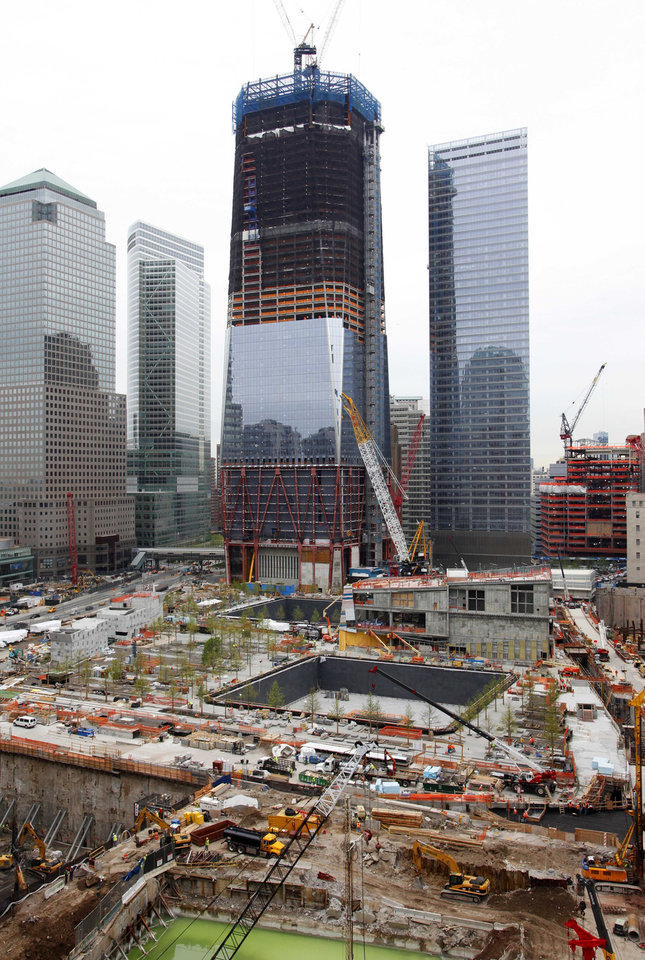 Photo - Work continues at the World Trade Center site and the Freedom Tower in New York on Monday, May 2, 2011. On Sunday, President Barack Obama announced Osama bin Laden was killed by U.S. forces in Pakistan. (AP Photo/Mark Lennihan) ORG XMIT: NYML111