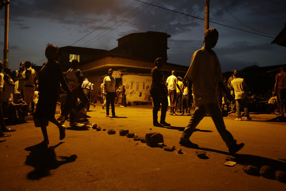 Rocks and stones are laid on the ground to mark the places for hundreds of voters turned out in line before dawn to queue outside a polling station in central Freetown, Sierra Leone, Saturday, Nov. 17, 2012. A decade after Sierra Leone's brutal civil war, voters on Saturday chose between an incumbent president who has provided new roads and free health care and a field of opposition candidates who decry the poverty and pace of economic recovery.(AP Photo/Rebecca Blackwell)