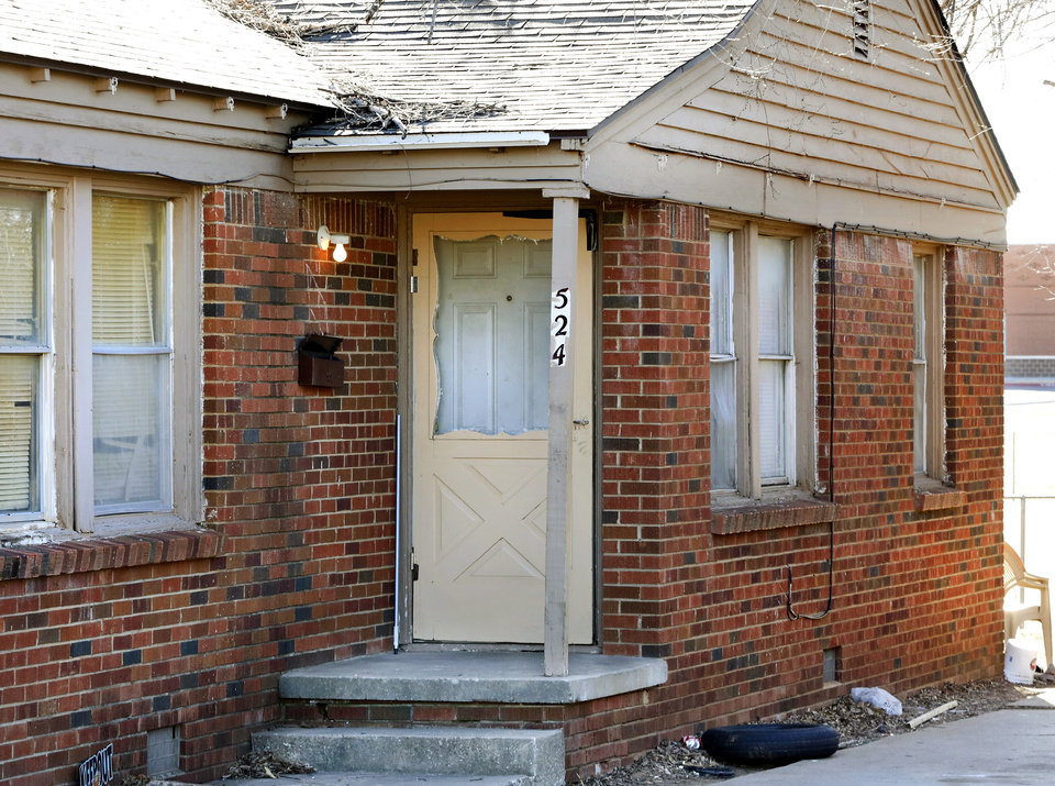 "Photo - The front door and driveway of the back half of a duplex, 524 E. Babb Drive. One neighbor told reporters that the woman who lived there escaped to safety with her two daughters out a rear window. Three people were found slain inside this Midwest City duplex Saturday night, Jan. 28, 2017, and law officers are seeking the person suspected of killing them. None of the victims' names nor the name of the suspected killer was released Sunday morning, but according to police, they knew each other. ""This was not a random act,"" Midwest City Police Chief Brandon Clabes said. On Saturday, about 8:50 p.m., a person placed a 911 call and said ""something bad"" had happened in the 500 block of E. Babb Drive, located near SE 15 and Key Blvd., about one mile north of Tinker Air Force Base. Three people were found dead inside the house, Clabes said.   Photo by Jim Beckel, The Oklahoman"