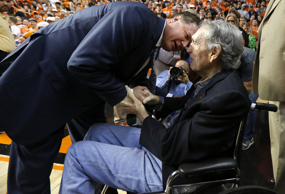 Photo - Kansas coach Bill Self greets former Oklahoma State coach Eddie Sutton after a game between the Oklahoma State University Cowboys (OSU) and the Kansas University Jayhawks at Gallagher-Iba Arena in Stillwater, Okla., Saturday, March 4, 2017. Kansas won 90-85. Photo by Bryan Terry, The Oklahoman
