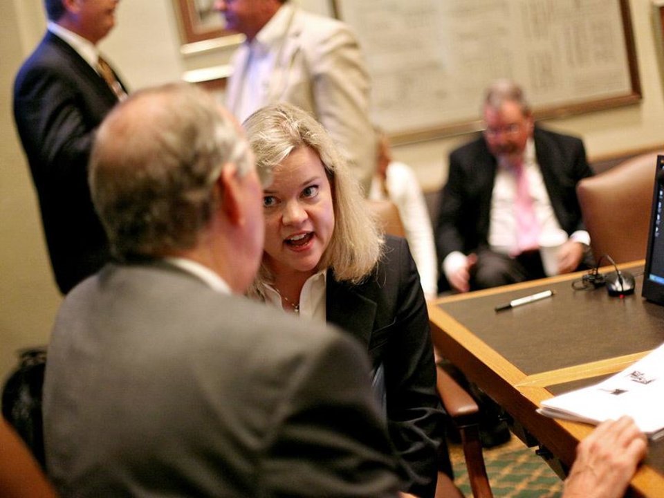 Photo - Mary Brinkley, President of Oklahoma Association of Homes and Services for the Aging, talks with legislators at the Oklahoma state Capitol in Oklahoma City on Tuesday, Sept. 22, 2009.  By John Clanton, The Oklahoman