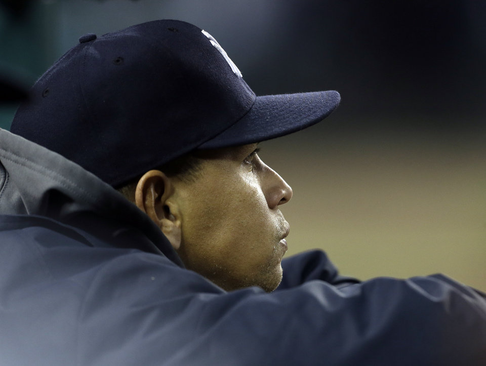 Photo -   New York Yankees' Alex Rodriguez watches from the dugout in the sixth inning during Game 3 of the American League championship against the Detroit Tigers series Tuesday, Oct. 16, 2012, in Detroit. (AP Photo/Paul Sancya )