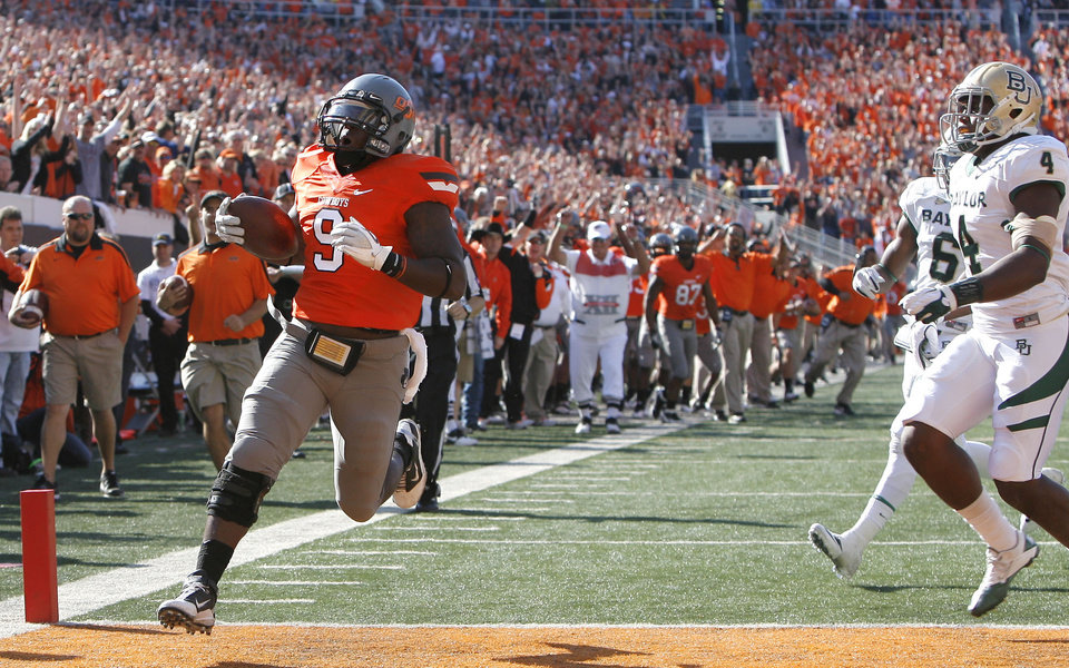 Oklahoma State\'s Kye Staley (9) scores a touchdown in front of Baylor\'s Elliot Coffey (4) and Ahmad Dixon (6) during a college football game between the Oklahoma State University Cowboys (OSU) and the Baylor University Bears (BU) at Boone Pickens Stadium in Stillwater, Okla., Saturday, Oct. 29, 2011. Photo by Sarah Phipps, The Oklahoman